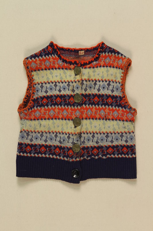 2005.175.4 front Child's blue, white and red striped button vest worn by a little girl while living in hiding