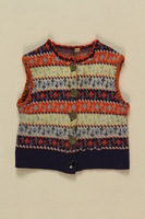 2005.175.4 front Child's blue, white and red striped button vest worn by a little girl while living in hiding  Click to enlarge