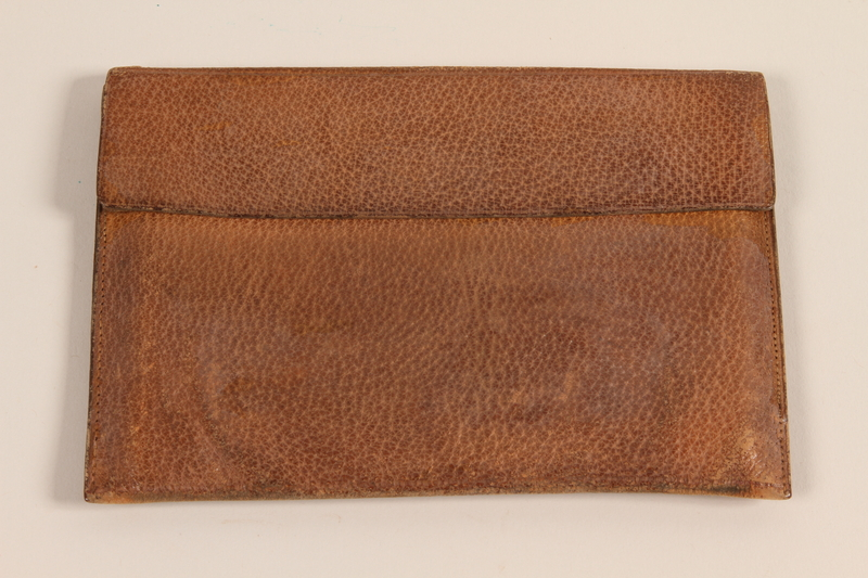2005.288.2 front Leather wallet with flap closure carried by a Jewish refugee from Nazi Germany to the US