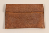 2005.288.2 front Leather wallet with flap closure carried by a Jewish refugee from Nazi Germany to the US  Click to enlarge