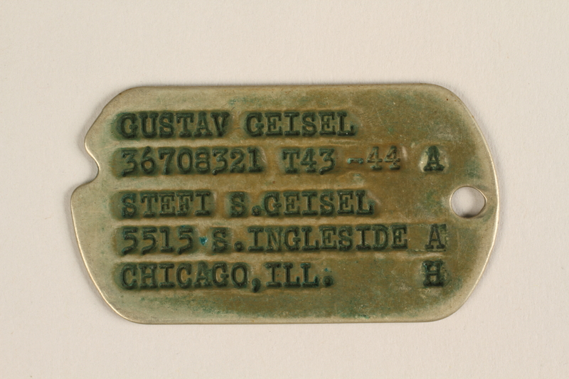 2005.288.3 front Metal identification tag used by Jewish refugees from Nazi Germany to the US