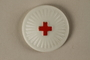 White pin with a red cross