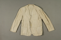 2005.369.1 front Man's long-sleeved linen jacket made in a displaced person's camp  Click to enlarge