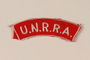 UNRRA red cloth patch with acronym worn by a refugee aid worker