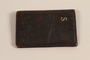 Dark brown leather wallet with metal S used by a Jewish refugee boy