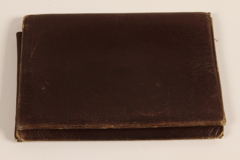 2005.379.5 front Brown leather billfold used by a Latvian Jewish refugee and aid worker from Nazi Germany