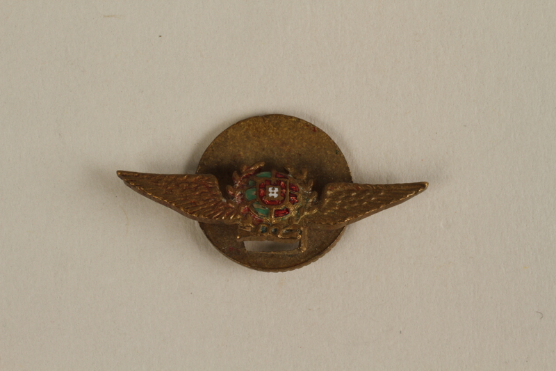 2005.379.9 front Wing shaped Portuguese Air Force pin given to a young Jewish refugee by friends in Lisbon