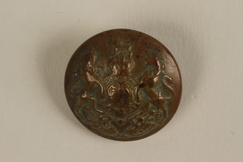 2005.379.11 front Button from a World War I British military uniform found by a young Jewish refugee in Belgium