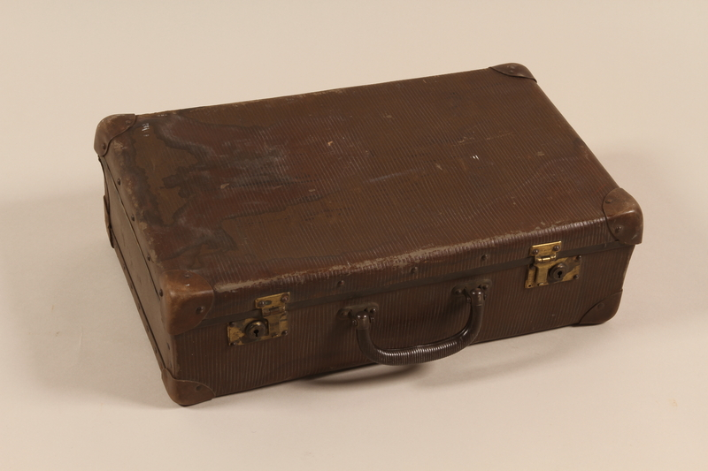 2005.415.3 front Brown textured suitcase used by a young German Jewish woman