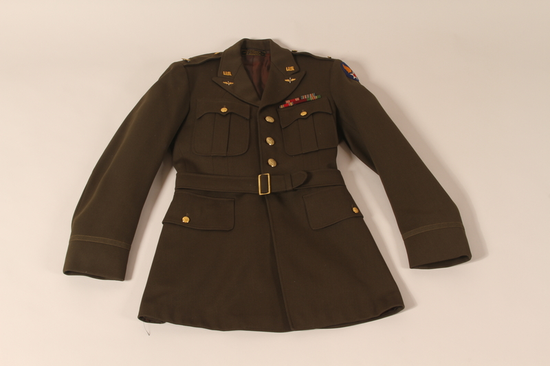 2005.416.2 front Olive drab dress uniform jacket in the style worn by a US Army officer