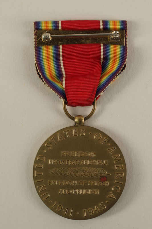 2005.416.4_a back World War II Victory Medal, ribbon and presentation box owned by a US soldier