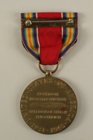 2005.416.4_a back World War II Victory Medal, ribbon and presentation box owned by a US soldier  Click to enlarge