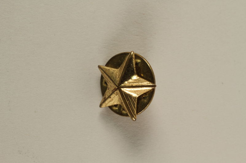 2005.416.5 front US Army soldier's 5-pointed star shaped gold pin