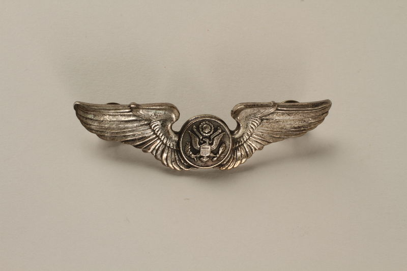 2005.416.8 front Sterling silver US Airman's wing crew pin owned by a US medic