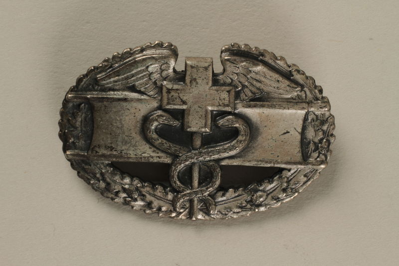 2005.416.9 front US Army Combat Medical award pin owned by a US soldier