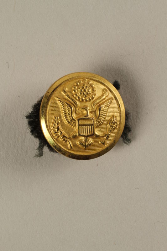 2005.416.18 front US Army soldier's gold button with an embossed eagle