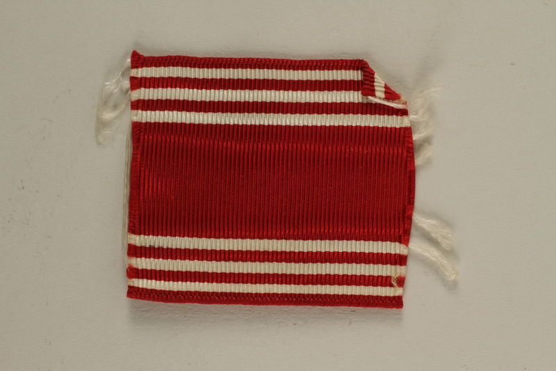 2005.416.21 front US Army soldier's red and white striped ribbon