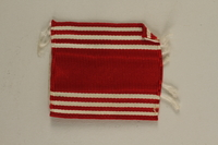 2005.416.21 front US Army soldier's red and white striped ribbon  Click to enlarge