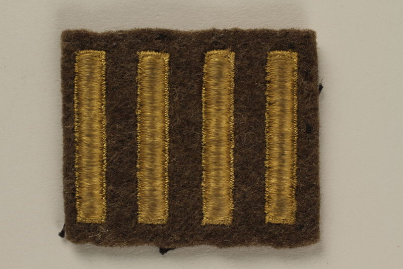 2005.416.22 front US Army soldier's green felt military patch with 4 gold stripes