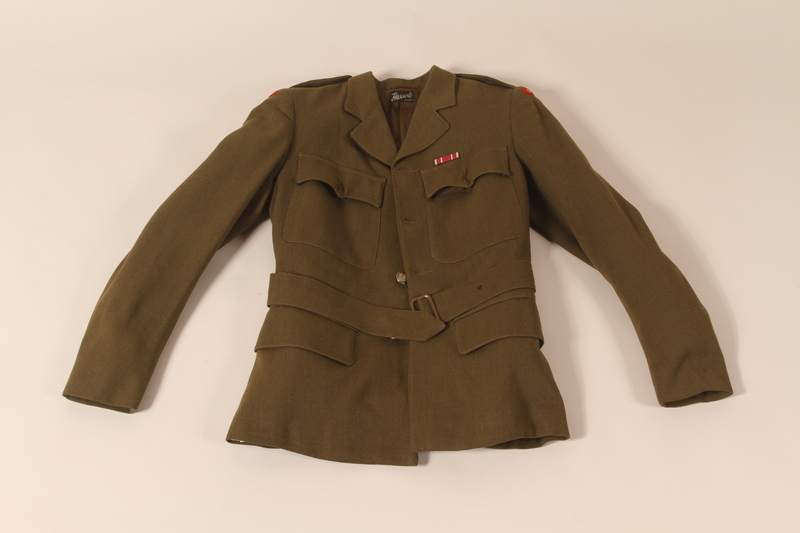 2002.539.2 a front Polish Army uniform skirt, jacket, blouse, collars and tie worn by a nurse