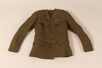 2002.539.2 a front Polish Army uniform skirt, jacket, blouse, collars and tie worn by a nurse  Click to enlarge