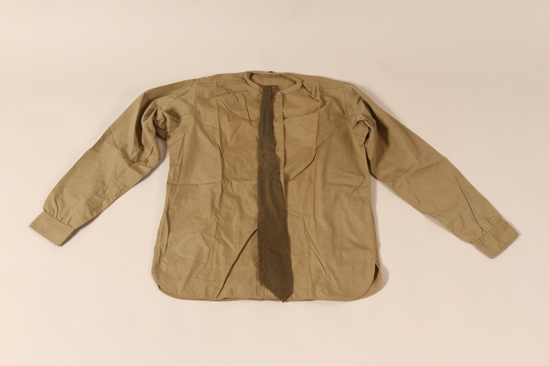 2002.539.2 d & g front Polish Army uniform skirt, jacket, blouse, collars and tie worn by a nurse