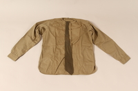 2002.539.2 d & g front Polish Army uniform skirt, jacket, blouse, collars and tie worn by a nurse  Click to enlarge