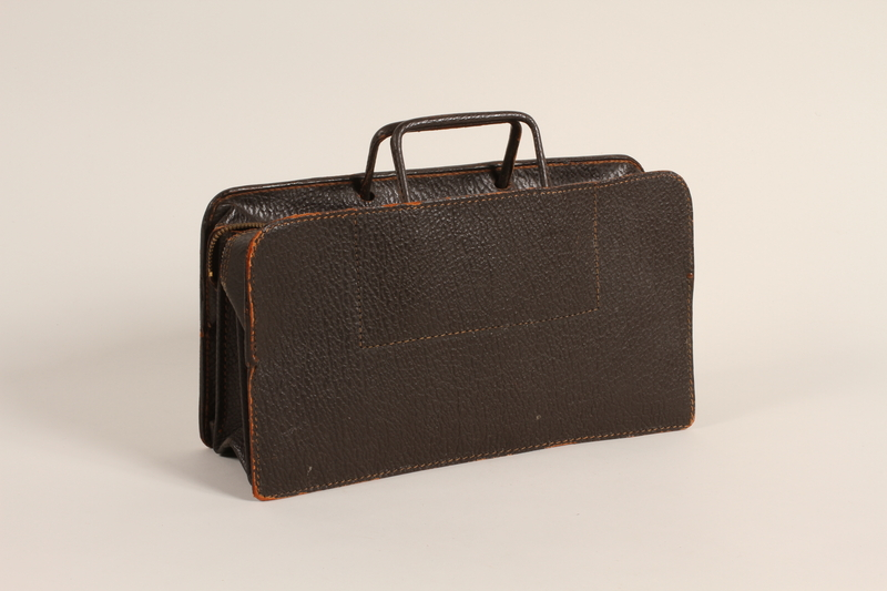 2005.427.2 front Dark brown leather satchel used by a Polish Jewish refugee