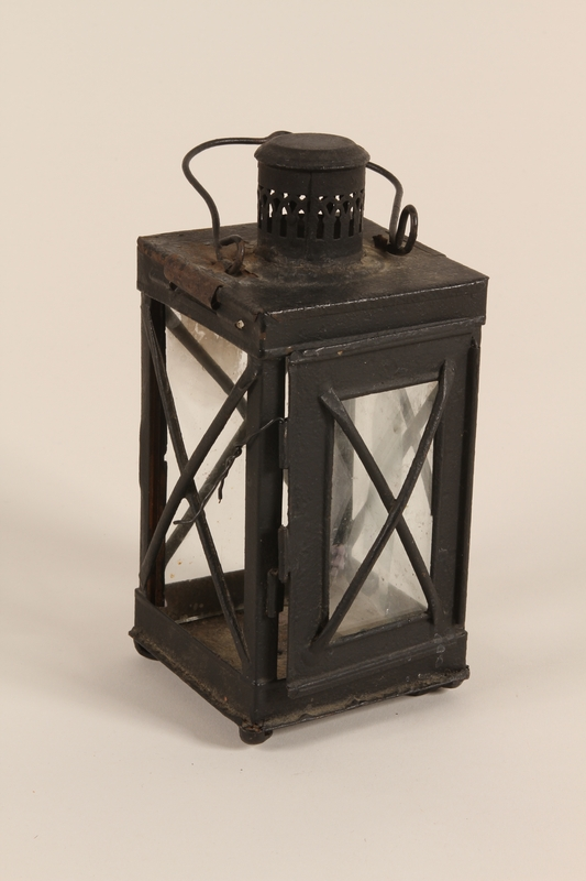 2005.453.2 a front Lantern and candle used by a Sinti family