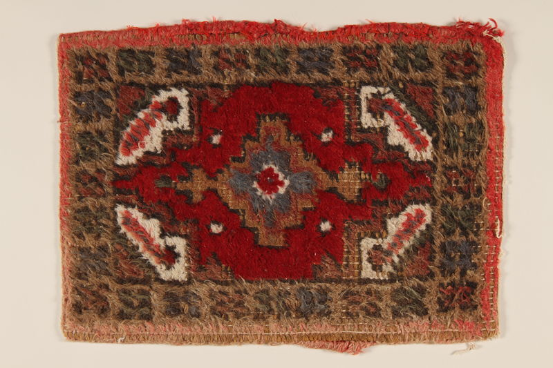 2005.453.7 front Small hooked rug used in the wagon of a Sinti family