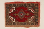 Small hooked rug used in the wagon of a Sinti family