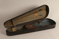 2005.453.10 open Violin case used by a Sinti musician  Click to enlarge