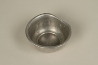 2005.457.10 front Small metal bowl used in a concentration camp  Click to enlarge