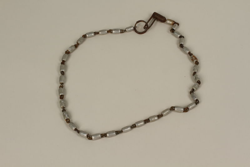 2005.457.18 front Chain of metal beads used by a barber in a concentration camp