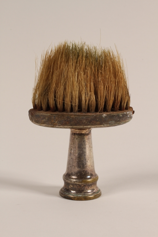 2005.457.35 front Barber's professional brush used in a concentration camp