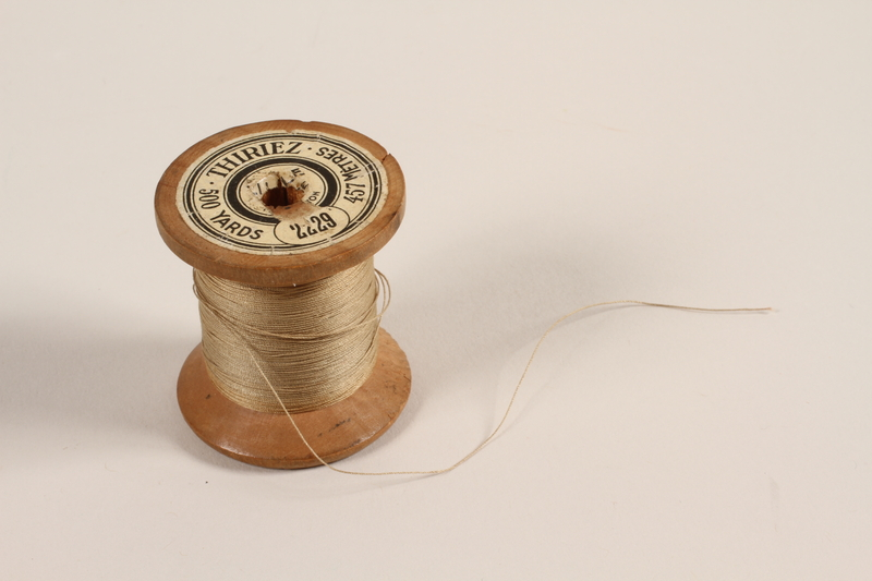 2005.463.2 front Wooden thread spool from tailoring shop in Paris