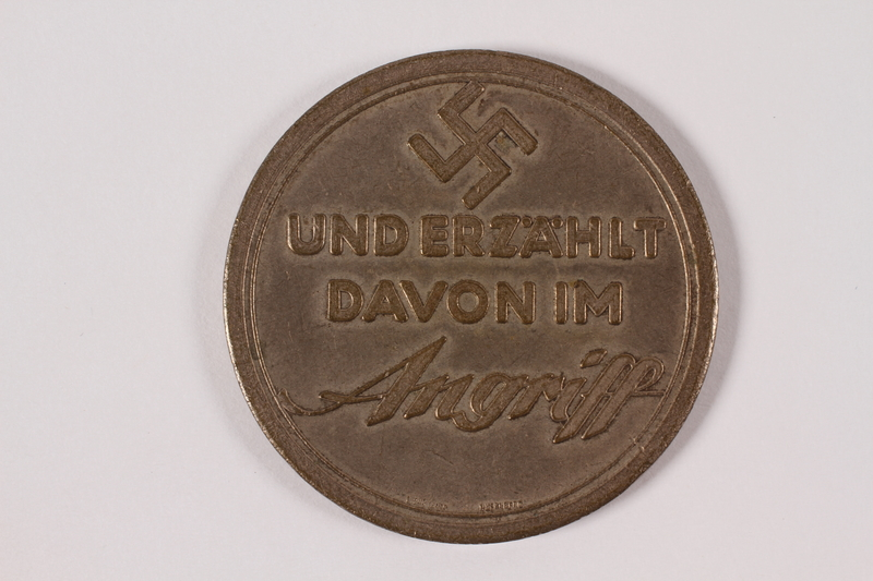 2005.464.1 back Souvenir coin with a swastika and Star of David owned by a young German Jewish girl