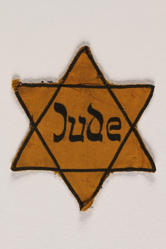 2004.721.2 front Star of David yellow cloth badge printed with Jude, the German word for Jew