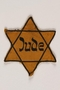 Star of David yellow cloth badge printed with Jude, the German word for Jew