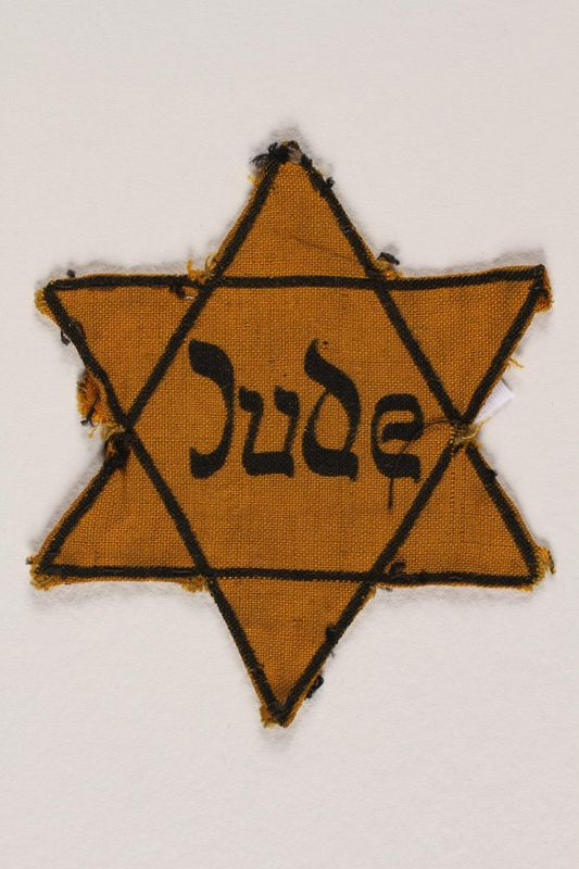2004.721.3 front Star of David yellow cloth badge printed with Jude, the German word for Jew