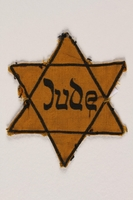2004.721.3 front Star of David yellow cloth badge printed with Jude, the German word for Jew  Click to enlarge