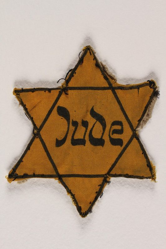 2004.721.4 front Star of David yellow cloth badge printed with Jude, the German word for Jew