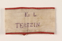 Handmade white armband stamped for medical personnel worn by an inmate in Theresienstadt