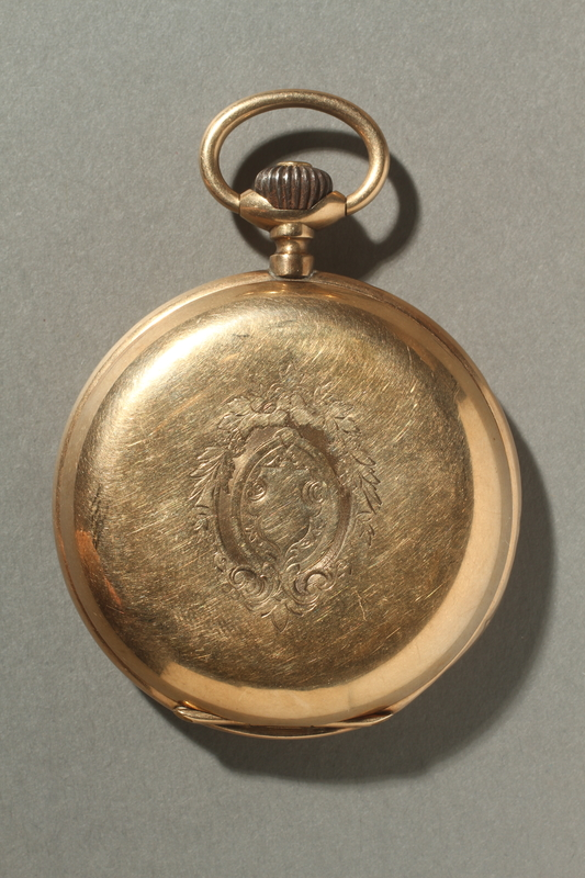 2005.546.2 front Gold engraved pocket watch owned by a German Jewish refugee