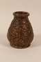 Handthrown ceramic vase with relief design of birds used by a German Jewish refugee family