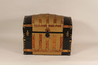 2005.564.4 front Large, gold painted tin camelback trunk used by a German Jewish refugee family  Click to enlarge