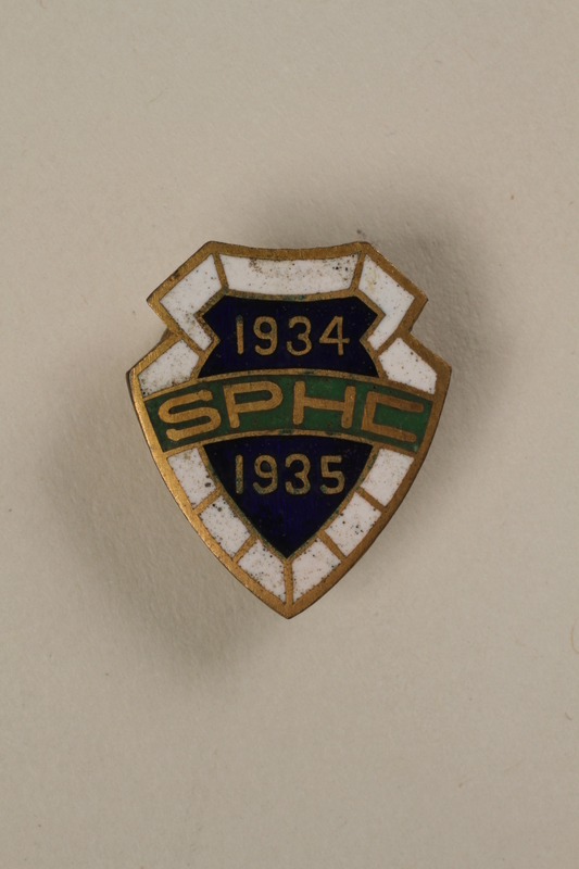 2006.19.11 front Shanghai Paper Hunt Club lapel button owned by a German Jewish businessman in Shanghai