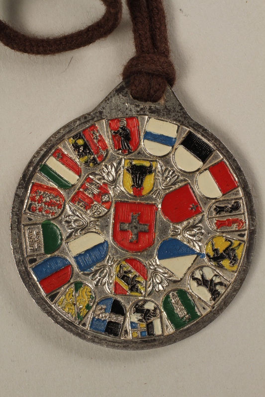 2006.19.16 back Decorative medal with St. Bernard with a ski and a dog owned by a German Jewsh businessman in Shanghai