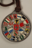2006.19.16 back Decorative medal with St. Bernard with a ski and a dog owned by a German Jewsh businessman in Shanghai  Click to enlarge