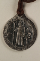 2006.19.16 front Decorative medal with St. Bernard with a ski and a dog owned by a German Jewsh businessman in Shanghai  Click to enlarge